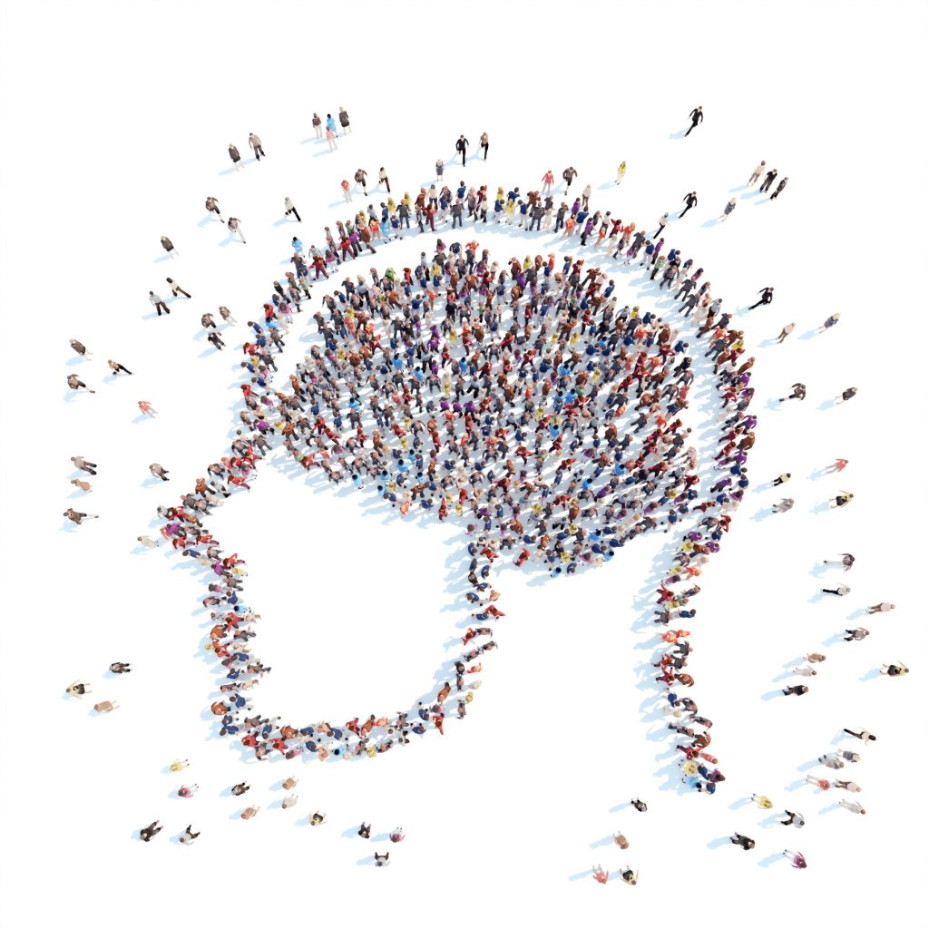 Många människor bildar formen av ett huvud och en hjärna.